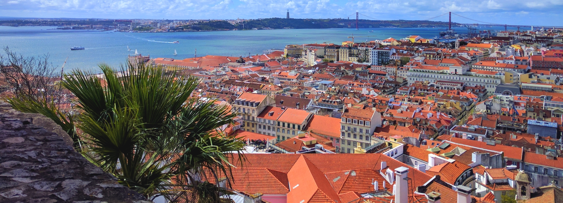 view from the castelo sao jorge with roofs and blue sky at treasures of lisboa food tours